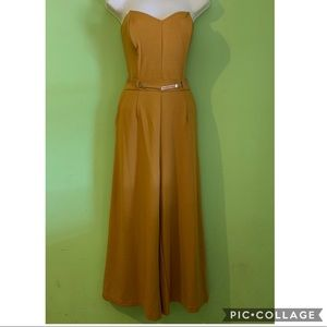 Mustard strapless belted culotte jumpsuit